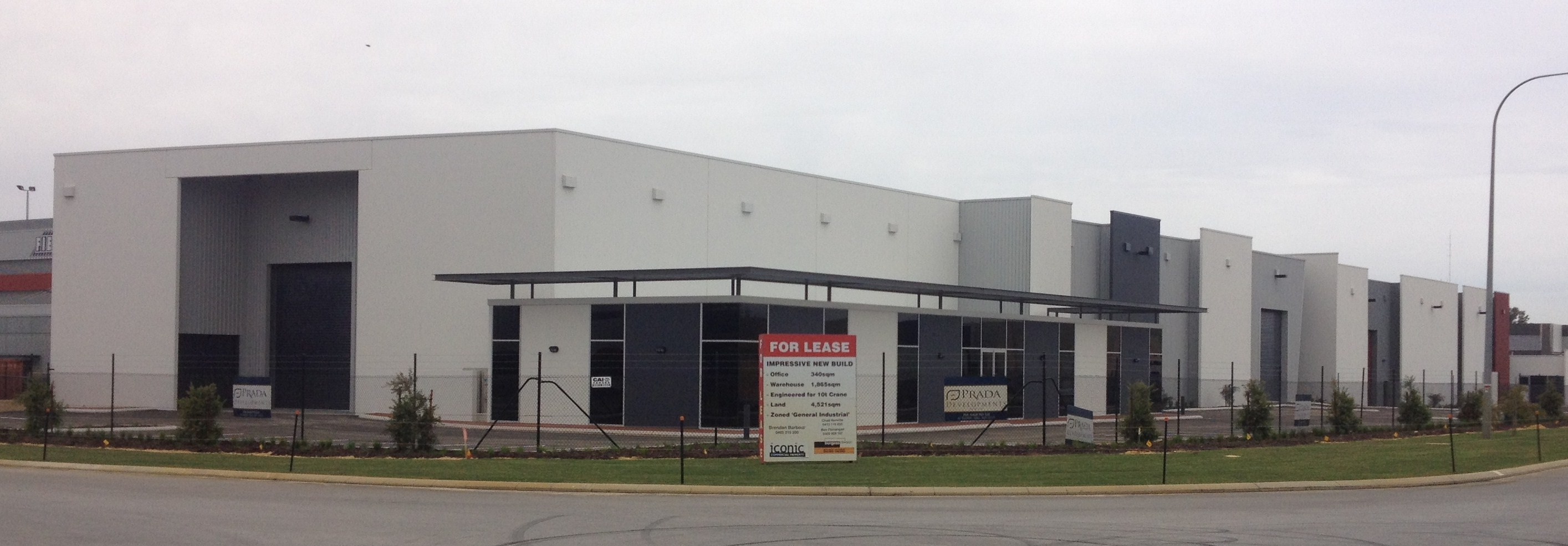 Exterior of commercial warehouse units, finished in tones of grey