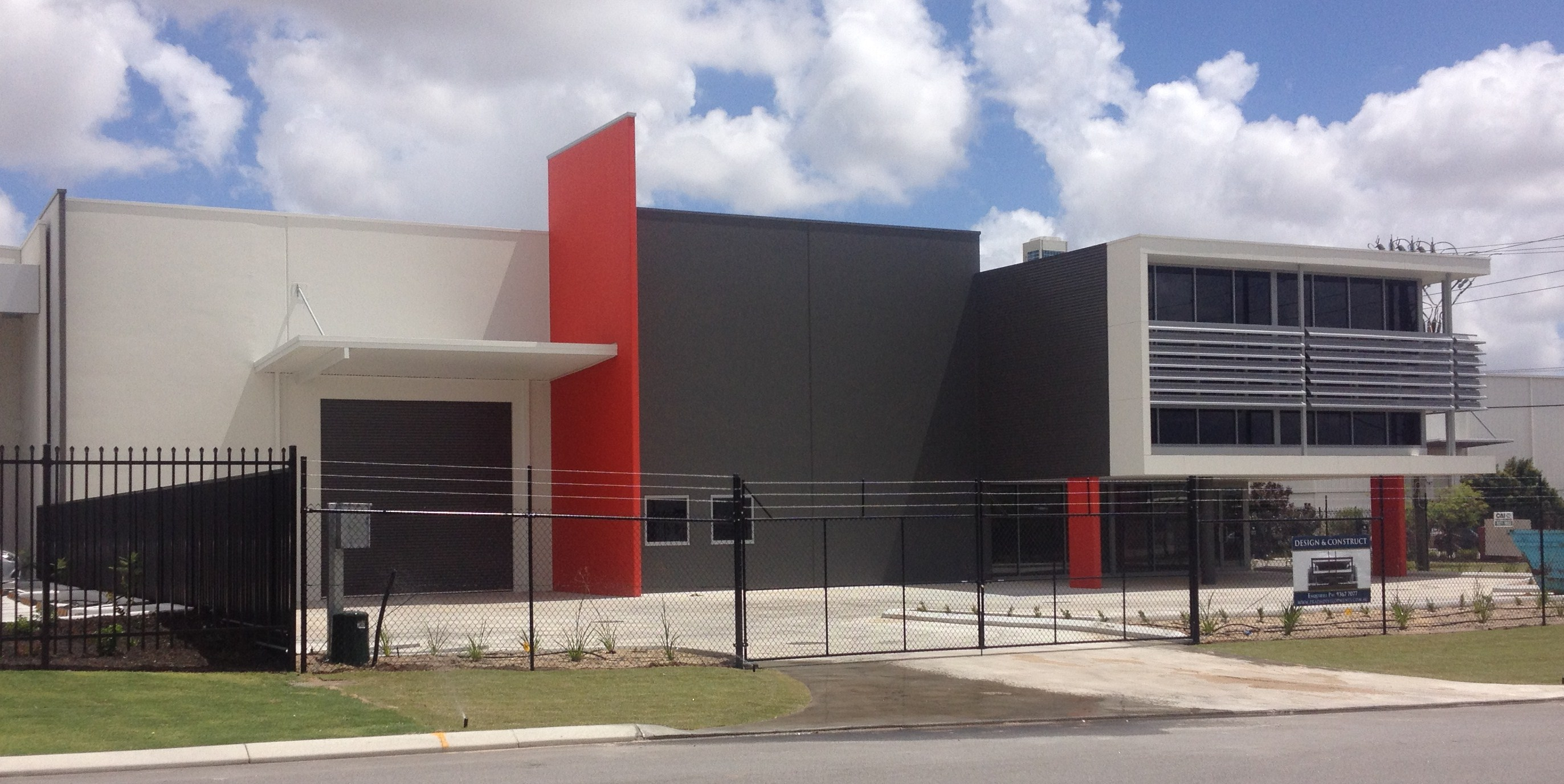 Red and grey painted commercial warehouse unit exterior