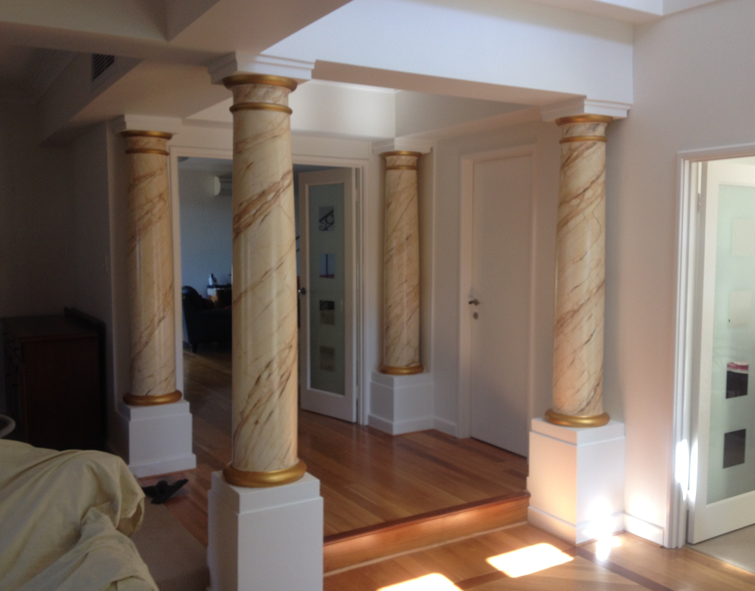 Interior shot of white painted walls and feature marble pillars