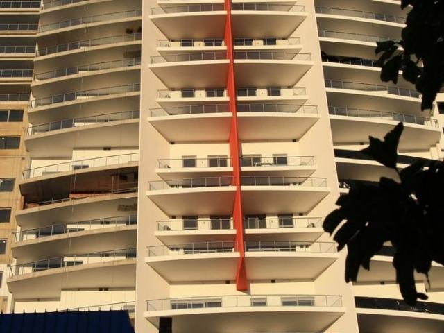 Large multilevel apartment complex painted in cream and orange