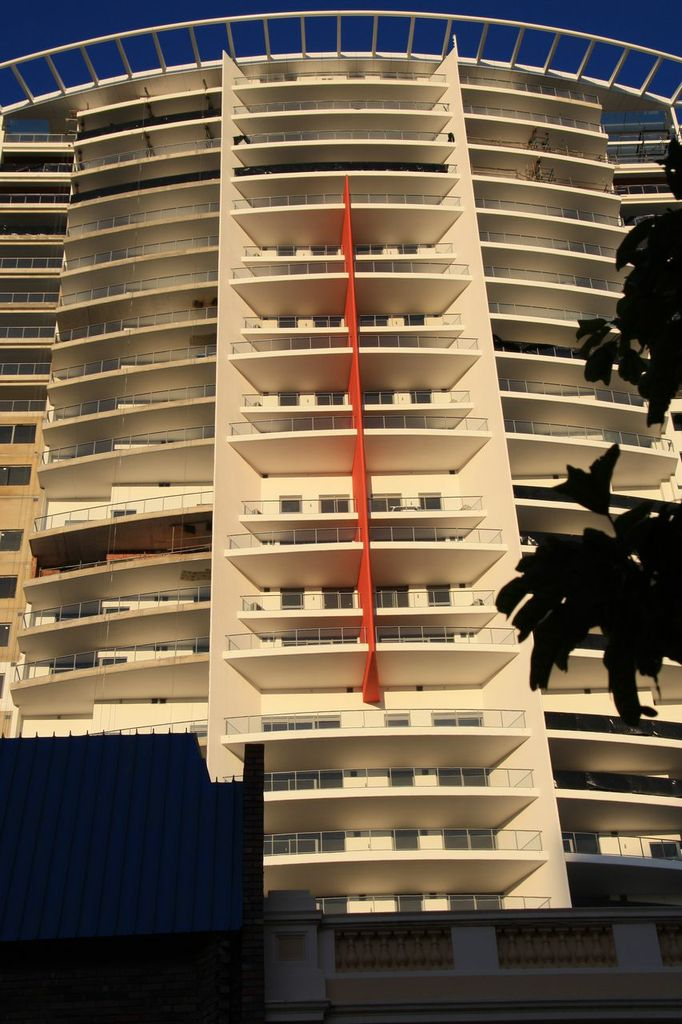 Large multilevel apartment complex painted in cream and orange