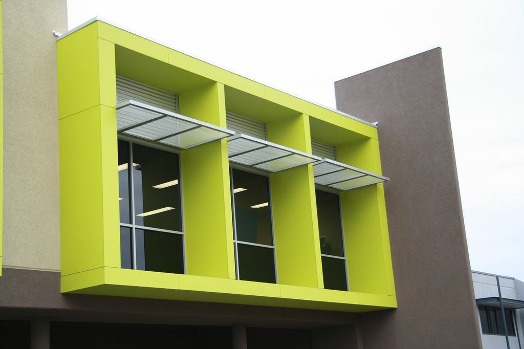 Exterior of office building, painted in vibrant lime green